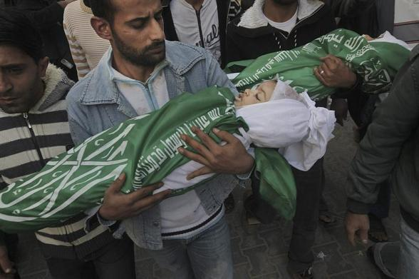 AA01. Gaza Strip (Zzzz), 18/11/2012.- Palestinians hold the bodies of Jumana Abu Sefan, 18 months old and her brother Tamer, three and a half years old, during their funeral in the northern Gaza Strip on 18 November 2012. Israel has put 75,000 reservists on standby amid speculation of an impending ground invasion EFE/EPA/ALI ALI