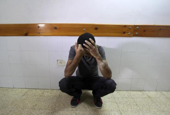 "A Palestinian mourns the death of Ahmed Abu Dagah, who was killed by gunfire from Israeli forces, at the morgue of a hospital in Khan Younis in the southern Gaza Strip November 8, 2012. Gunfire from Israeli forces killed a Palestinian boy, Abu Dagah, in the Gaza Strip on Thursday, local medics said, during border clashes between the Israeli military and Palestinian militants. Israeli military officials said soldiers who were engaged in ""routine activity"" adjacent to the security fence came under attack from Palestinian militants and responded ""by firing at suspicious locations"". REUTERS/Ibraheem Abu Mustafa"