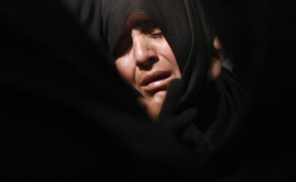 "The mother of Ahmed Abu Dagah, who was killed by gunfire from Israeli forces, mourns during his funeral in Khan Younis in the southern Gaza Strip November 9, 2012. Gunfire from Israeli forces killed the Palestinian boy, Abu Dagah, in the Gaza Strip on Thursday, local medics said, during border clashes between the Israeli military and Palestinian militants. Israeli military officials said soldiers who were engaged in ""routine activity"" adjacent to the security fence came under attack from Palestinian militants and responded ""by firing at suspicious locations"". REUTERS/Mohammed Salem"