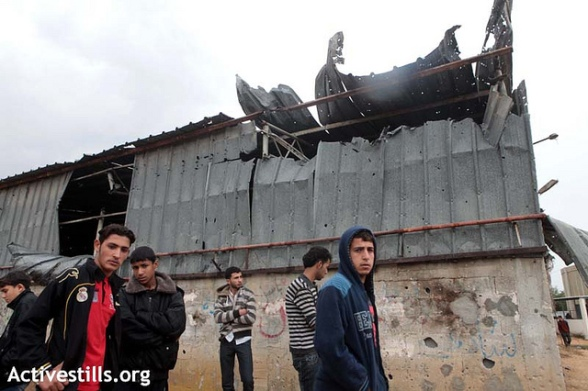 Palestinians gather in front of a damaged building in the location where the day before Israeli shelling killed 4 Palestinians and injured more than 20, in the al-Shoja'iya neighborhood east of Gaza City , November 11, 2012. In total 6 Palestinians were killed and more than 50 injured, some of them serious. Photo by: Anne Paq/Activestills.org