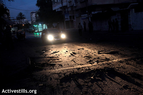 Photo: Debris on road of the location of strike which killed the head of Hamas' military wing, Ahmed Jabari  Gaza, Photo via @ActiveStills