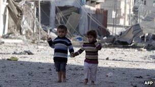 Nov 18, 2012 Children walking through the rubble