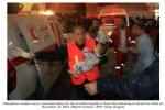medics_carry_wounded_palestinian_baby_following_israeli_air_stricke[1]