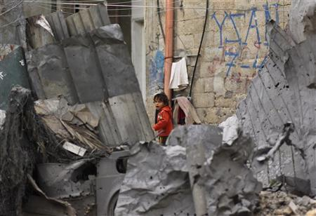 A girl looks at, what Palestinians say, is a house damaged in an Israeli air strike in Jabalya, in the northern Gaza Strip November 11, 2012. REUTERS/Mohammed Salem