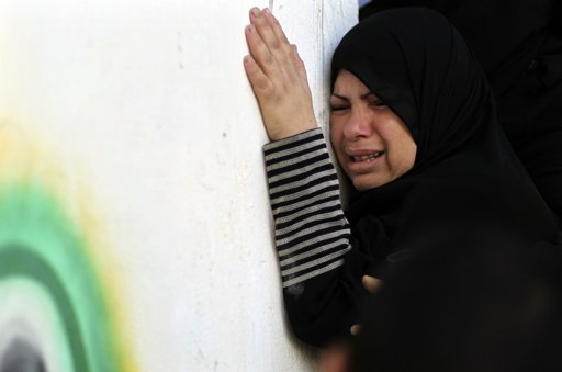 A Palestinian relative of Hamas militant Mohammed Qanoua, who died of wounds suffered from Israeli tank fire, mourns during his funeral in Gaza City November 13, 2012. Israel struck three targets in the Gaza Strip in the early hours of Tuesday and warned an on-going crisis with Palestinian militants had not been resolved, despite a marked decrease in rocket-fire from the territory. Tensions rose sharply on Saturday when four Israeli soldiers patrolling the Israel-Gaza border were wounded. Israel responded with tank fire and air strikes that killed seven Palestinians, including four civilians, and left at least 40 wounded. REUTERS/Mohammed Salem