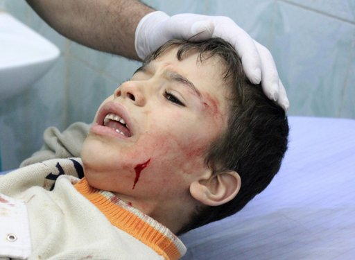 "A wounded Palestinian boy reacts as he receives treatment in a hospital after an Israeli air strike in the northern Gaza Strip November 18, 2012. Israel bombed militant targets in Gaza for a fifth straight day on Sunday, launching aerial and naval attacks as its military prepared for a possible ground invasion, though Egypt saw ""some indications"" of a truce ahead. REUTERS/Stringer"