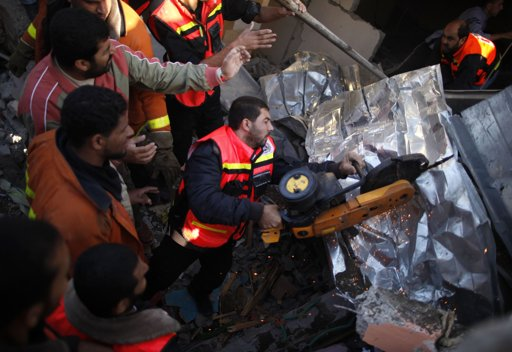 "Members of the Palestinian Civil Defense use equipment to cut through metal as they search for victims under the rubble of a destroyed house after an Israeli air strike in Gaza City November 18, 2012. Israel bombed militant targets in Gaza for a fifth straight day on Sunday, launching aerial and naval attacks as its military prepared for a possible ground invasion, though Egypt saw ""some indications"" of a truce ahead. REUTERS/Suhaib Salem"