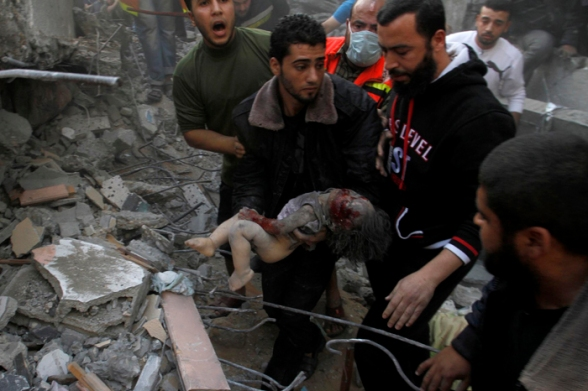 PHOTO | Children slayed by #Israel covered with rubble of bombed homes in Gaza Nov 18, 2012 Photo by Wafa
