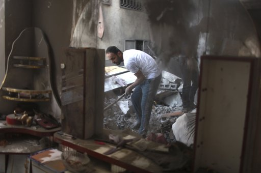 A Palestinian man is reflected in a mirror as he inspects his damaged house after an Israeli air strike in Gaza City November 19, 2012. Hostilities between Islamist militants and Israel entered a sixth day on Monday as diplomatic efforts were set to intensify to try to stop rocket fire from the Gaza Strip and Israeli air strikes on Gaza. International pressure for a ceasefire seemed certain to mount after the deadliest single incident in the flare-up on Sunday claimed the lives of at least 11 Palestinian civilians, including four children. REUTERS/Mohammed Salem