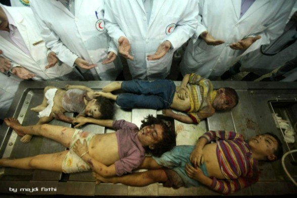 Doctors in the hospital making du'a for the dead children. 