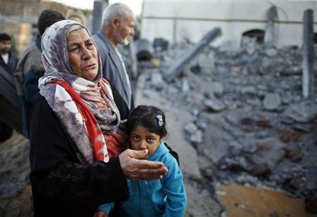 A Palestinian woman cries next to a relative's house after it was destroyed in what witnesses said was an Israeli air strike in Beit Lahiya in the northern Gaza Strip November 20, 2012. REUTERS/Suhaib Salem