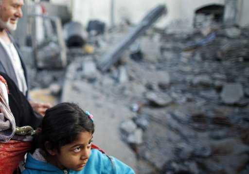 A Palestinian girl stands next to a relative's house after it was destroyed in what witnesses said was an Israeli air strike in Beit Lahiya, in the northern Gaza Strip, November 20, 2012. International pressure for a ceasefire in the Gaza Strip puts Egypt's new Islamist president in the spotlight on Tuesday after a sixth day of Palestinian rocket fire and Israeli air strikes that have killed over 100 people. REUTERS/Suhaib Salem
