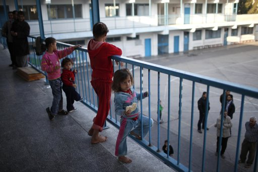 Palestinian children of the Balata family, who fled their house, are seen as they stay at a United Nations-run school in Gaza City November 20, 2012. From the sandy expanses of the northern Gaza Strip, Palestinian families are fleeing their homes destroyed by airstrikes, but refuse to blame the Hamas rocket crews who draw Israeli fire. REUTERS/Ahmed Jadallah