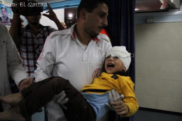 Nov 21 2012 Child wounded Photo by Omar Al Qatta - Gaza Under Attack