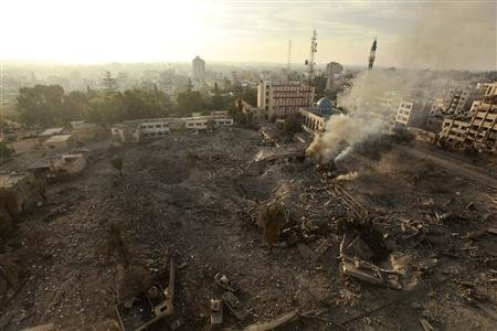 A general view of destroyed government offices is seen after what witnesses said was an Israeli air strike in Gaza City November 21, 2012. Israeli air strikes shook the Gaza Strip and Palestinian rockets struck across the border as U.S. Secretary of State Hillary Clinton held talks in Jerusalem in the early hours of Wednesday, seeking a truce that can hold back Israel's ground troops. REUTERS/Mohammed Salem