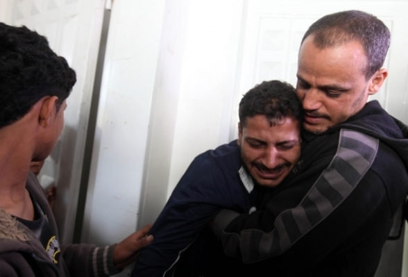 Nov 21 2012 Man mourning over the loss of a relative in Gaza Morgue