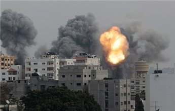 Smoke and explosion are seen during Israeli airstrikes in Gaza City  Nov. 21, 2012. (Reuters/Ahmed Jadallah)