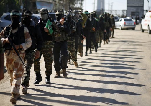 "Palestinian members of the al-Qassam brigades, the armed wing of the Hamas movement, patrol a street as they await the arrival of Hamas chief Khaled Meshaal in Rafah in the southern Gaza Strip December 7, 2012. Hamas's exiled leader Meshaal will step onto Palestinian land for the first time in 45 years on Friday for a ""victory rally"" in the Gaza Strip, displaying his newfound confidence after last month's conflict with Israel. Meshaal, the Islamist group's leader, who has not visited the Palestinian Territories since leaving the West Bank at age 11, emerged emboldened from the eight day conflict which ended in a truce he negotiated under Egypt's auspices. He has since spoken of reaching out to other Palestinian factions. EUTERS/Mohammed Salem"