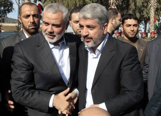 Hamas chief Khaled Meshaal (front R) walks with senior Hamas leader Ismail Haniyeh (front L) upon his arrival at the Rafah crossing in the southern Gaza Strip December 7, 2012. Meshaal arrived in the Gaza Strip on Friday, ending 45 years of exile from Palestinian land with a visit that underscored the Islamist group's growing confidence following a recent conflict with Israel. REUTERS/Ahmed Jadallah