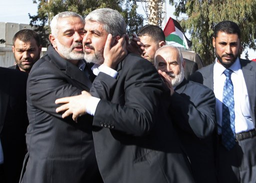 Senior Hamas leader Ismail Haniyeh (L) kisses Hamas chief Khaled Meshaal upon Meshaal's arrival at the Rafah crossing in the southern Gaza Strip December 7, 2012.  Photo by Ahmad Jadallah/Reuters