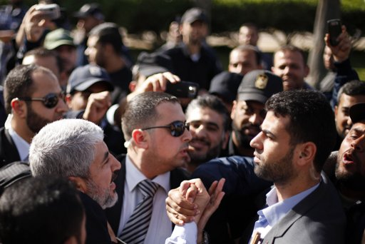 Hamas chief Khaled Meshaal (bottom L) shakes hands with supporters upon his arrival at Rafah crossing in the southern Gaza Strip December 7, 2012.  Photo By SUHAIB SALEM/REUTERS
