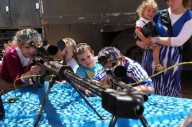 Israeli children play with rifles during