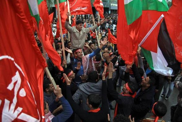 Nablus (---), 08/12/2012.- Palestinian supporters of the Popular Front for the Liberation of Palestine (PFLP) carry Palestine National flags and the party flag during a rally to mark the 45th anniversary of the establishment of the PFLP in the West Bank City of Nablus 08 December 2012.