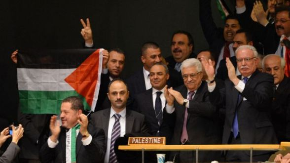 Acting Palestinian Authority chief Mahmoud Abbas (2nd R) and the Palestinian delegation celebrate after the UN General Assembly voted to upgrade the status of Palestine, New York, November 29, 2012.