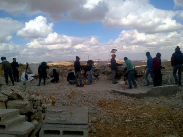 Dec 22 2012 Clearing the rubble left from the mosque that the Israeli army demolished last week