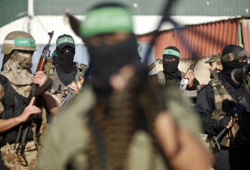 """Palestinian members of al-Qassam brigades, the armed wing of the Hamas movement, stand guard as they wait for the arrival of Hamas chief Khaled Meshaal in Rafah in the southern Gaza Strip December 7, 2012. Hamas's exiled leader Meshaal will step onto Palestinian land for the first time in 45 years on Friday for a """"victory rally"""" in the Gaza Strip, displaying his newfound confidence after last month's conflict with Israel. Meshaal, the Islamist group's leader, who has not visited the Palestinian Territories since leaving the West Bank at age 11, emerged emboldened from the eight day conflict which ended in a truce he negotiated under Egypt's auspices. He has since spoken of reaching out to other Palestinian factions. REUTERS/Mohammed Salem"""