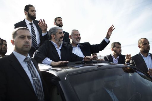 "Exiled Hamas leader Khaled Meshaal (3rd left) and Gaza Strip premier Ismail Haniya (3rd right) during a parade in Rafah, southern Gaza. Meshaal has crossed into the Gaza Strip on his first-ever visit, kissing the ground and hoping he would one day die a ""martyr"" in the Palestinian territory"