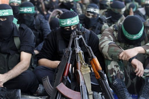 "Palestinian militants with the Ezzedine al-Qassam brigade -- the armed wing of Hamas -- pray as they await the arrival of the Islamist movement's exiled chief Khaled Meshaal in the Gaza Strip. Meshaal has crossed into the Gaza Strip on his first-ever visit, kissing the ground and hoping he would one day die a ""martyr"" in the Palestinian territory"