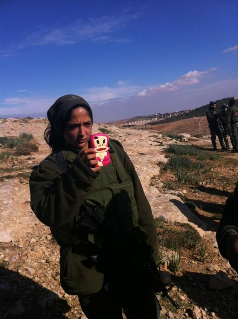 Soldier filming us with her iphone, maybe to tell her FB friend how strong she is on Palestinians