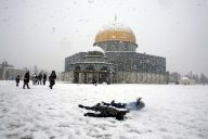 Palestinian children play in the snow in front of the Dome of the Rock on the compound known to Muslims as al-Haram al-Sharif and to Jews as Temple Mount, in Jerusalem's Old City January 10, 2013. The worst snowstorm in 20 years shut government offices, public transport and schools in Jerusalem and along the northern Israeli region bordering on Lebanon on Thursday. REUTERS/Ammar Awad