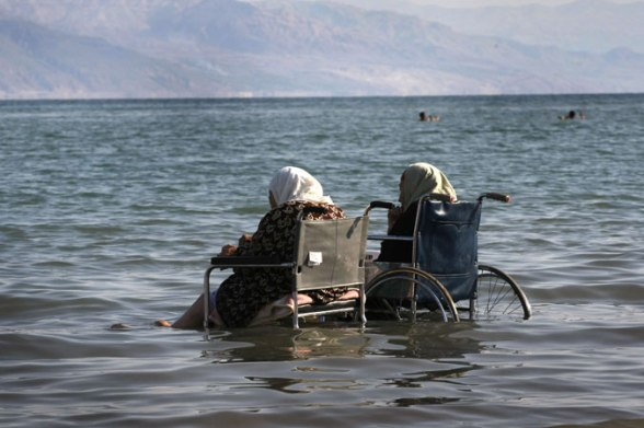 Palestinian women in wheelchairs enjoy the water at the Dead Sea in the West Bank. Photo by Mehanem Kehana Febr 10, 2008