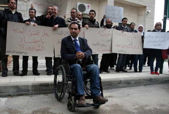 March 30, 2012  Osama Silwadi at a protest outside detained journalist Yousef al-Shayab's court hearing in Ramallah on Wednesday. (Issam Rimawi / APA images)