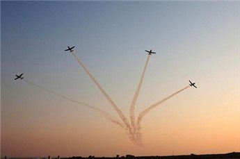Texan II T-6 training aircrafts fly in formation during an air force  pilots' graduation ceremony in southern Israel. (Reuters/Nir Elias, File)