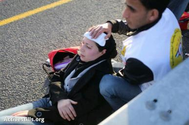 A medic treats a Palestinian woman injured by israeli police at #babalshams   Photo by ActiveStills