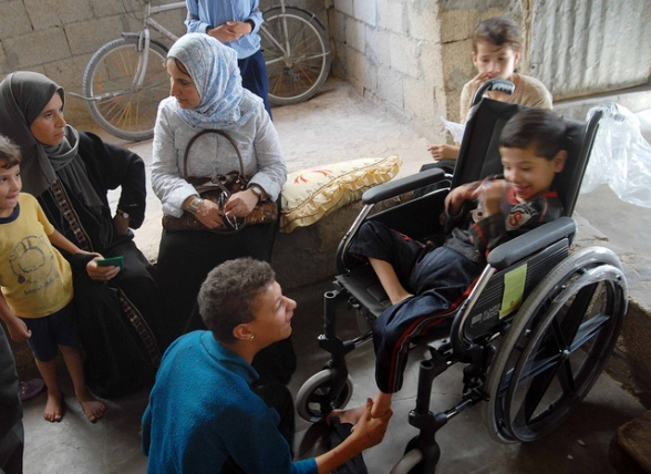 Sept 25, 2008 | A new wheelchair provided by members of AFSC's Palestine Youth Program delights a Gazan boy. Photo by AFSC