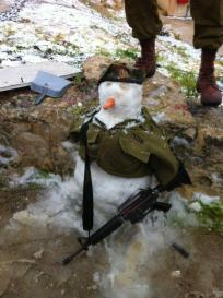 A militant snowman, build by Israeli soldiers.
