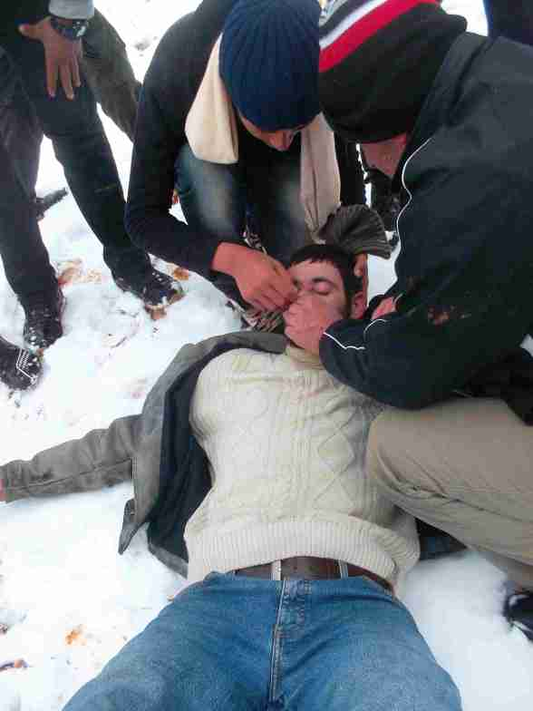 Qusra-villager-collapses-due-to-tear-gas-inhalation  Photo by ISM Palestine
