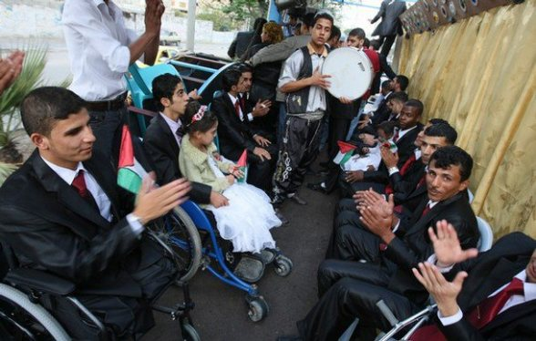 "June 2012 - Fifty handicapped war victims exchanged wedding vows in a mass wedding ceremony. They were highly injured and became physically disabled during Israel's military offensive on Gaza in late 2008.  About 1400 Palestinians inluding hundreds of children lost their lives during the ""Operation Cast Lead"" by the Israeli military. This wedding was organized by the charities and aid convoys including the al-wafa Aid Convoy from Italy, which arrived recently via Rafah crossing to give a new ray of hope towards life for these handicapped war victims."