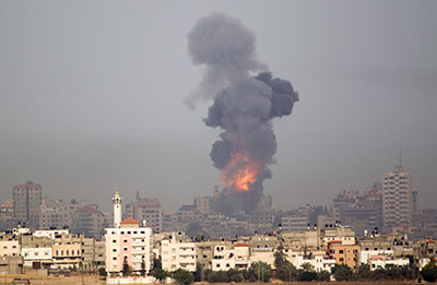 Smoke rises following an Israeli airstrike on Gaza on November 17, 2012. (AP/Ariel Schalit)