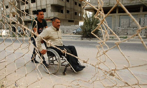 Aug 15, 2012 The son of Palestinian Paralympic athlete Khamis Zaqout pushes him on a wheelchair in Gaza City. Wheelchair-bound Zaqout from Gaza, lost the use of his legs while working on a building site in Israel two decades ago. He is Palestine's best hope for a Paralympic medal in London this month and will compete in the shot put, discus and javelin. Photograph: Ibraheem Abu Mustafa/Reuters