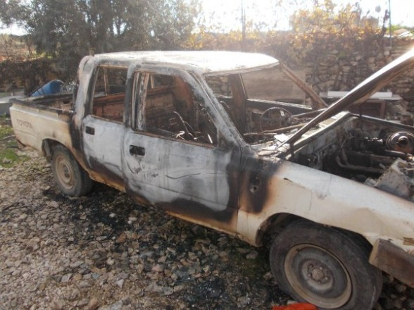 Israeli settlers burn two vehicles and spray paint racist slogans on a Palestinian home in Beit Ummar http://palsolidarity.org/2013/01/israeli-settlers-burn-two-vehicles-and-spray-paint-racist-slogans-on-a-palestinian-home-in-beit-ummar/