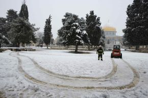 | A Palestinian worker stands next to a snowplow in front of the Dome of the Rock on the compound known to Muslims as al-Haram al-Sharif and to Jews as Temple Mount, in Jerusalem's Old City during a snowstorm January 10, 2013. The worst snowstorm in 20 years shut government offices, public transport and schools in Jerusalem and along the northern Israeli region bordering on Lebanon on Thursday. REUTERS/Ammar Awad