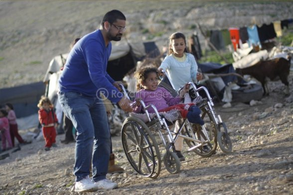Jan 15 2013 Disabled Palestinian child in Jordan Valley receives new wheelchair - Photo by RAYA