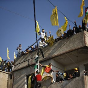 Palestinians stand atop a building as they take part in a rally marking the 48th anniversary of the founding of the Fatah movement, in Gaza City January 4, 2013. Fatah held its anniversary rally for the first time in Gaza Strip since 2007. REUTERS/Suhaib Salem
