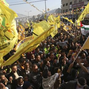 Palestinians Fatah supporters take part in a rally in the West Bank city of Nablus marking the 48th anniversary of the founding of the Fatah movement January 3, 2013. REUTERS/Abed Omar Qusini