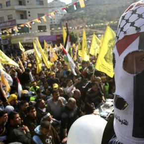 A Palestinian youth takes part in a rally in the West Bank city of Nablus marking the 48th anniversary of the founding of the Fatah movement January 3, 2013. REUTERS/Abed Omar Qusini